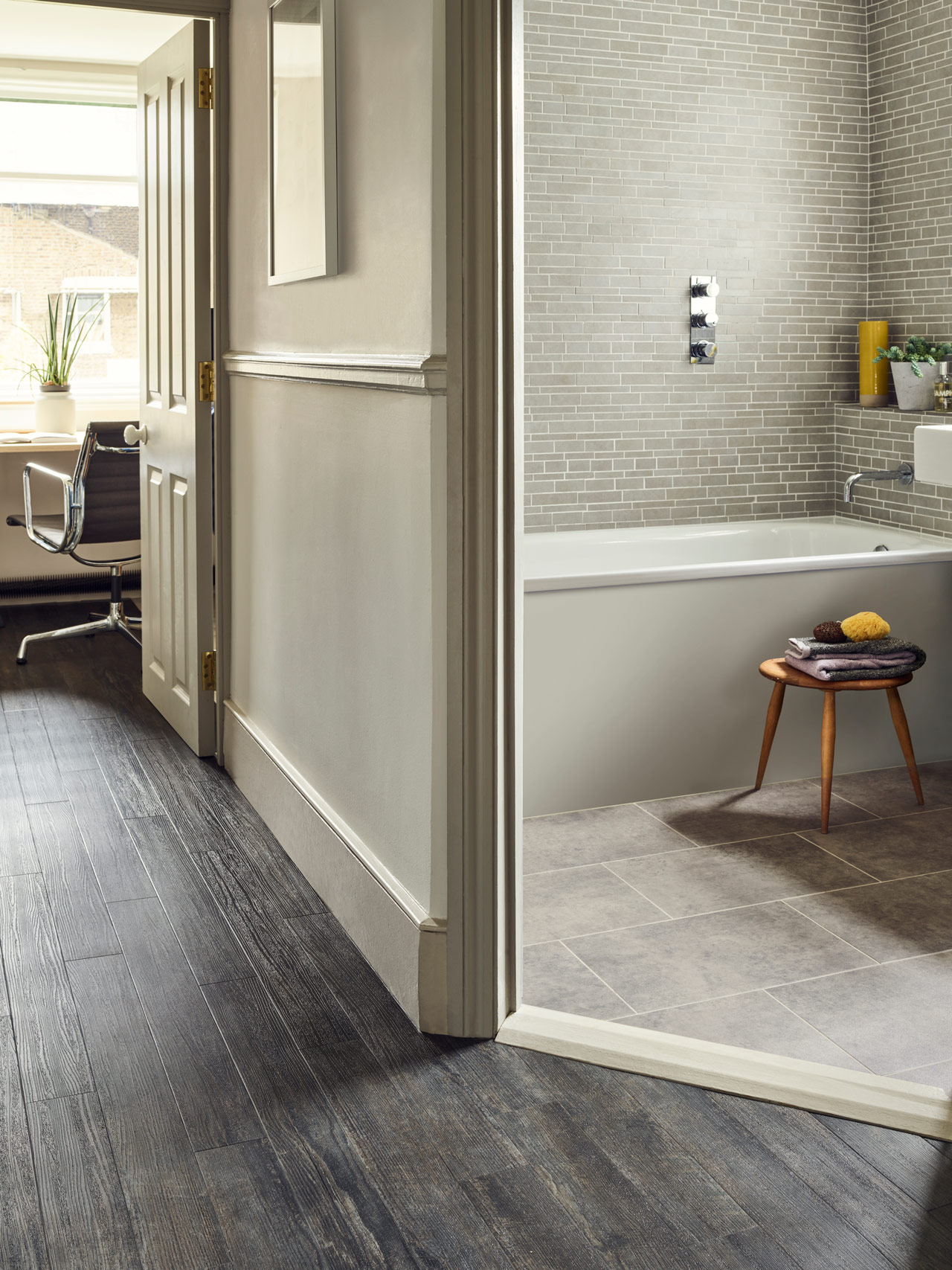 Hallway: Amtico Spacia Blackened Spa Wood (SS5S3069) in a Stripwood laying pattern. Bathroom: Amtico Spacia Century Concrete (SS5S3069) with Concrete Pale stripping in Broken Bond laying pattern