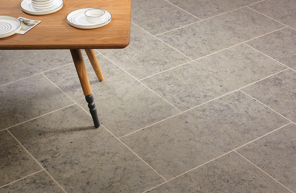 Buckland Stone with Riverstone Tundra stripping in Herringbone Tile laying pattern