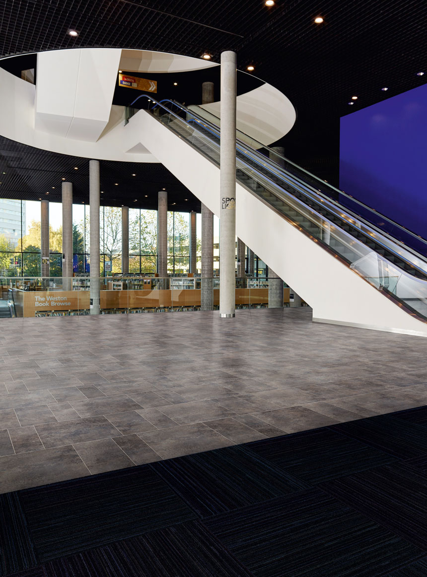 Amtico LVT works with Entryway carpet - also by Amtico, designed to protect a heavily used floor in public spaces like this library