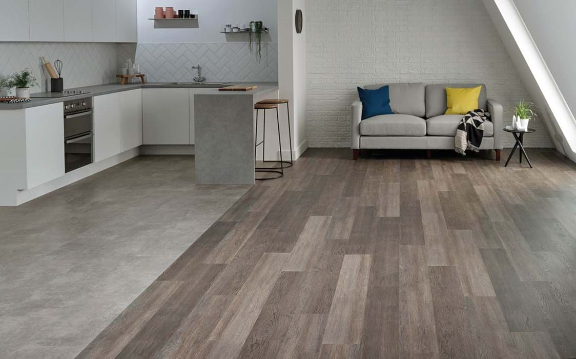 Amtico First Gallery Concrete (SF3S3071) in a Bonded Stone laying pattern with Dutch Oak (SF3W2778) in Stripwood laying pattern