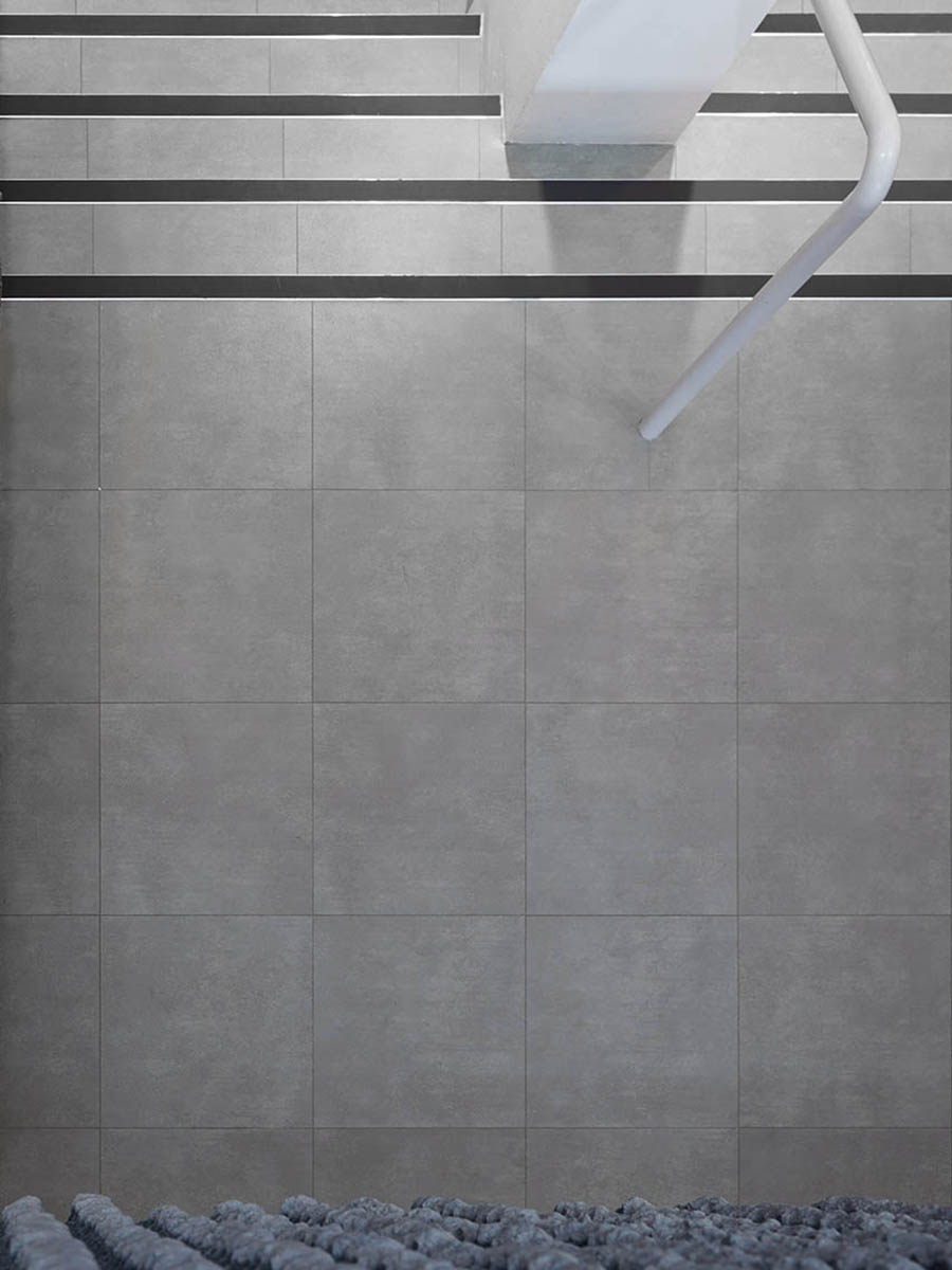 Amtico Spacia 36 Plus Metropolis Smoke in a Uniform Tile Laying Pattern.