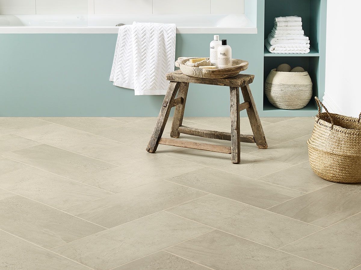 Amtico Form, Crema laid in a herringbone tile laying pattern.