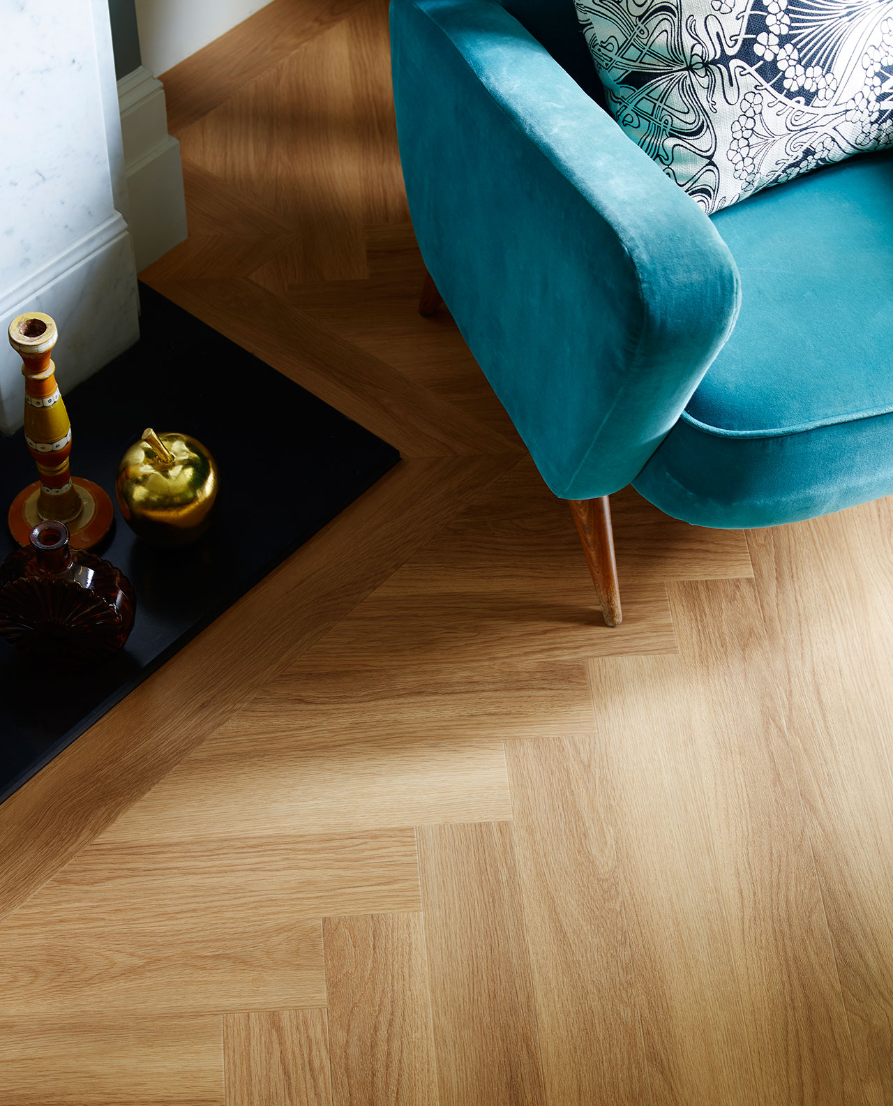 Amtico Spacia LVT in Honey Oak (SS5W2504) in Large Jumbo Herringbone Laying Pattern
